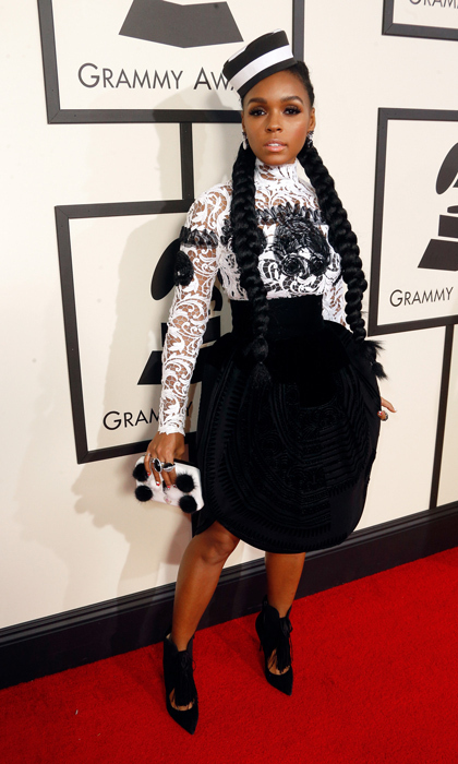 <h3>Janelle Monáe in Jean Paul Gaultier</h3><p>Jailbird? Sailor? Perfume bottle? Janelle Monae's circle skirt and striped hat kept us guessing.</p><p>Photo: © Getty Images</p>
