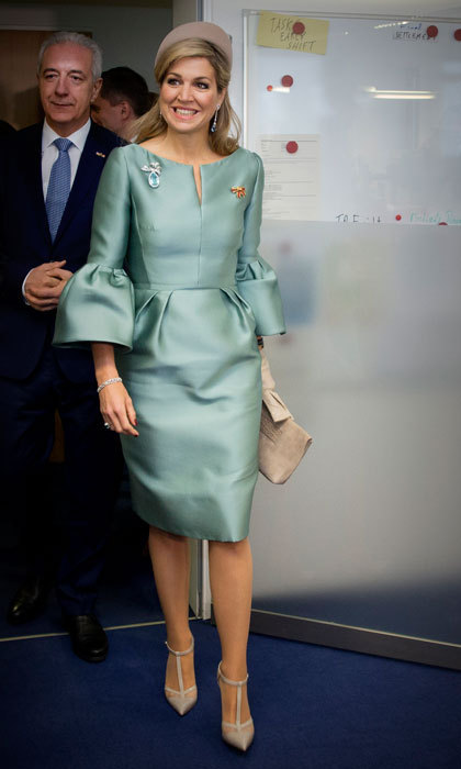 Queen Máxima was a vision in a sea foam green dress with trumpet sleeves, which she wore for her visit to the European Energy Exchange in Leipzig, Germany. 