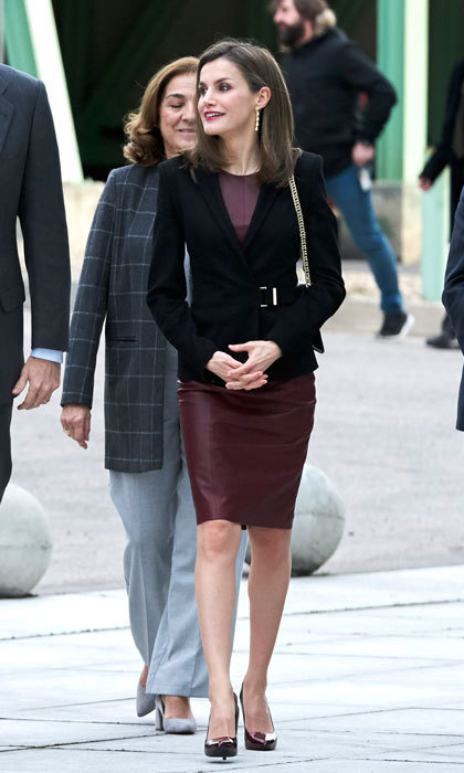 Queen Letizia stepped out to the National Center for Cardiovascular Research Foundation in Madrid wearing a burgundy leather dress. The Spanish monarch paired the edgy frock with her BOSS blazer and LODI ombre patent pumps.