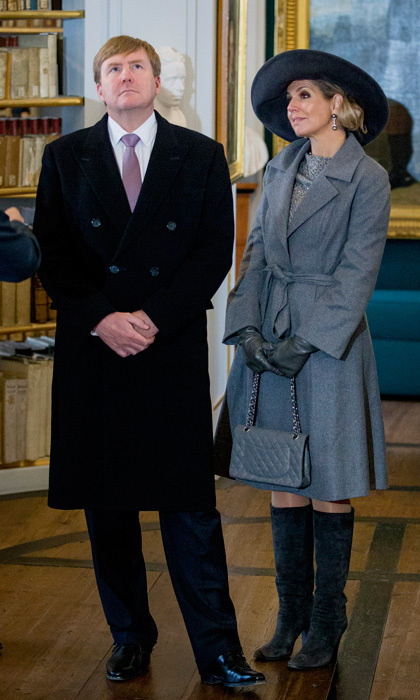 Queen Máxima looked fifty shades of grey and chic accessorizing with suede boots, Chanel bag and wide-brimmed hat as she appeared alongside husband King Willem-Alexander at the Hertogin Anna Amalia Bibliotheek in Erfurt, Germany. 