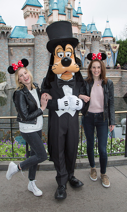 <em>Downton Abbey</em> stars Laura Carmichael and Michelle Dockery made friends with Goofy outside Mickey's castle. 