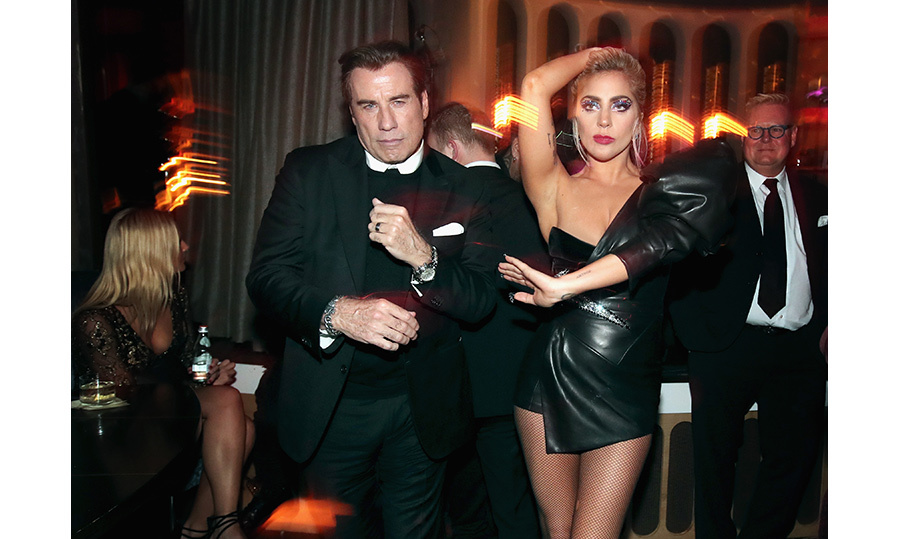 The party didn't stop after the final award was handed out! Lady Gaga found a willing dance partner in none other that John Travolta at a post-GRAMMYs bash. 