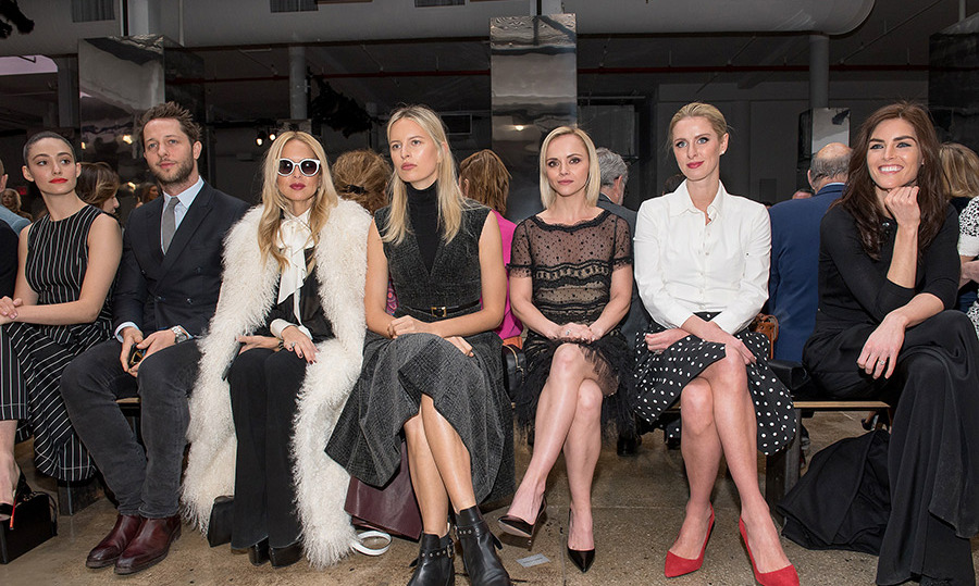 (L-R) Emmy Rossum, Derek Blasberg, Rachel Zoe, Karolina Kurkova, Christina Ricci, Nicky Hilton Rothschild and Hilary Rhoda at Carolina Herrera. 