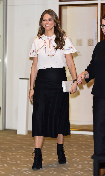 Princess Madeleine of Sweden opted for a floral print cape blouse and black midi skirt for her visit to the Imagine Children's festival in London, where she opened the 'Room for Children' at the Royal Festival Hall.