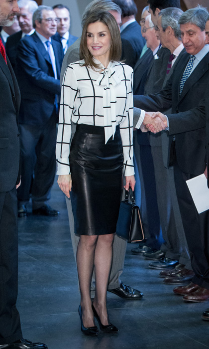 Queen Letizia of Spain embodied business-chic in a black leather skirt and a checkered pussybow blouse by Roberto Verino for the El Valor Economico del Espanol conference in Madrid.