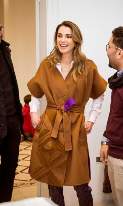 "Queen Rania looked effortlessly stylish in a camel coat for her outing to the Phi Science Institute. The Jordanian monarch captioned the Instagram photo, ""Teaching science with a dynamic approach that appeals to children and staying away from standard methods. A meeting rich with entrepreneurial spirit to improve learning!""