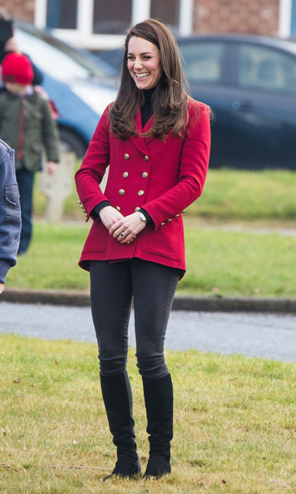 The Duchess of Cambridge was Valentine's Day-ready wearing a red double-breasted twill blazer by Philosphy Di Lorenzo Serafini, which she paired with a black turtleneck and jeans, for her visit with the RAF Air Cadets at RAF Wittering in Stamford, England.