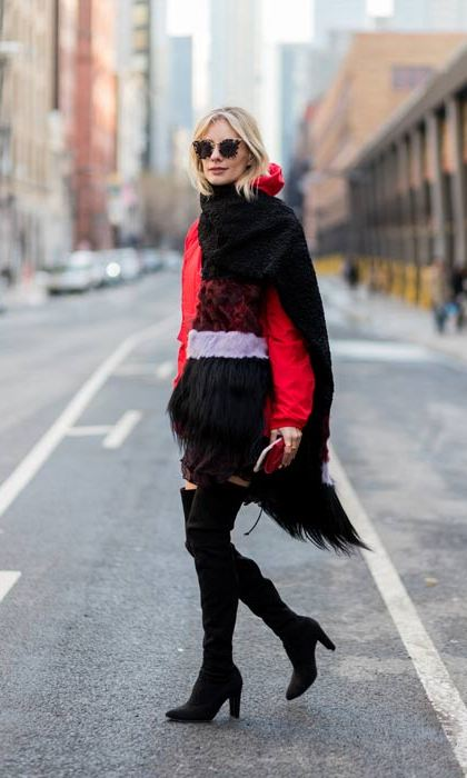 A statement oversized scarf, over the knee boots and shades ensure this look ticks all the street style boxes.  