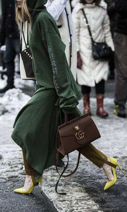 Yellow heels and a Gucci handbag add a fashion-forward spin to this laid-back look.