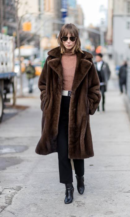 An oversized faux fur coat is a must for the wintry New York weather. 