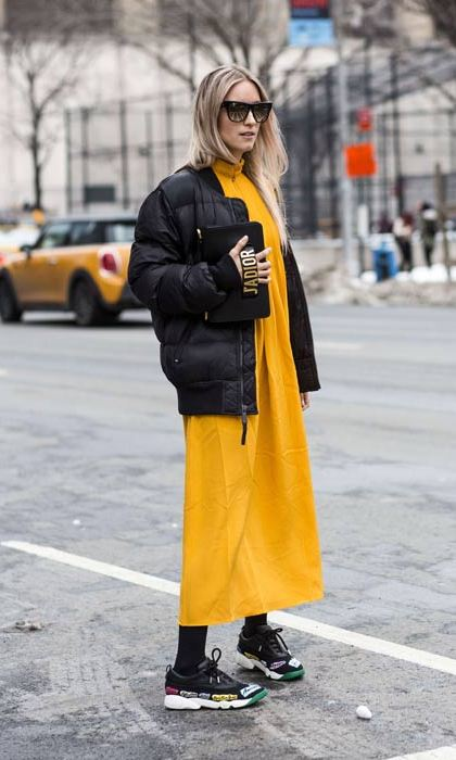 Rocking two trends in one with this yellow dress and padded jacket combo.
