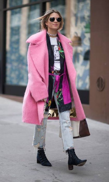 A statement pink coat ensures this street style star turns heads.