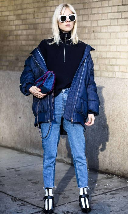 A padded jacket, statement shades and eye-catching boots... effortless street style doesn't get much better than this.