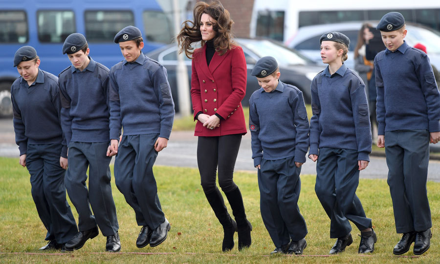 Kate let her hair fly as she played jumping games with young cadets during her visit to an RAF base in Cambridgeshire in February 2017. The Duchess couldn't help but giggle as she joined in the fun.