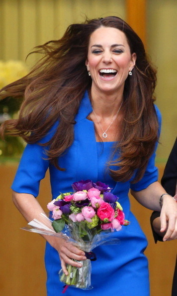 A laughing Kate (and her gorgeous shiny mane of hair) took centre stage as she left Northolt High School in 2014, where she had officially opened The ICAP Art Room.