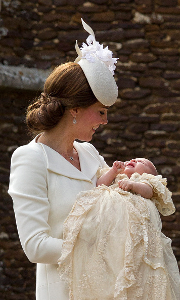 The proud mum shared a tender moment with daughter Charlotte during the little Princess's christening.