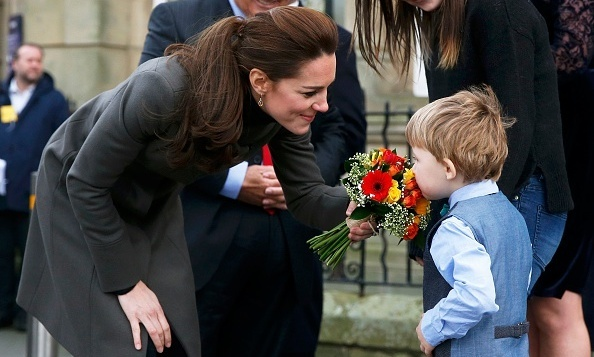 The Duchess showed off her maternal side as she met a young boy while visiting the GISDA centre in Wales.