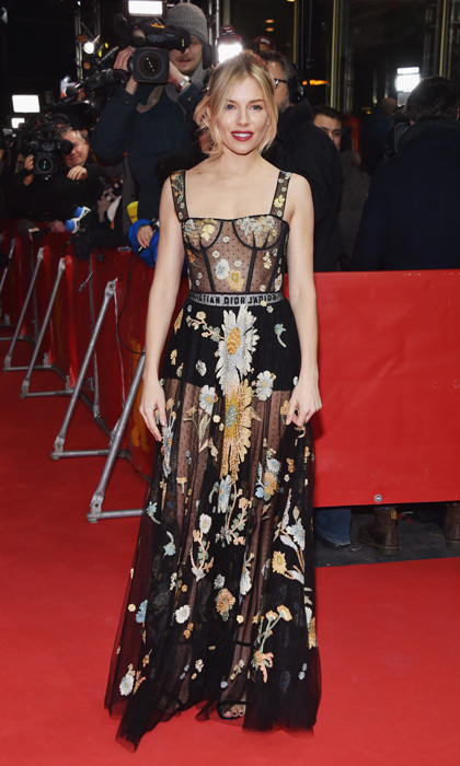 <strong>Feb. 14:</strong> Sienna Miller brought flower power to <em>The Lost City of Z</em> in Berlin, Germany wearing a floral printed frock by Dior.