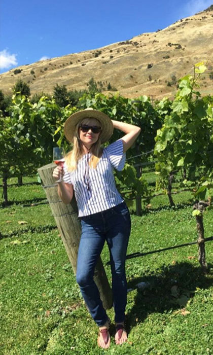 """Happy Sunday! soaking up the sun in gorgeous #newzealand!"" Reese captioned a snap as she explored a nearby vineyard. ""Hope you are having a beautiful day!""