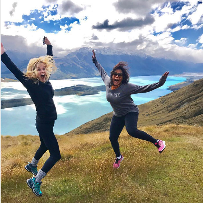 """Couldn't be more excited to discover #NewZealand with this lady!!! @mindykaling,"" Reese captioned one quirky photo as she and close friend Mindy Kaling celebrated their arrival by jumping and pulling excited faces with Lake Hawea providing a stunning backdrop.