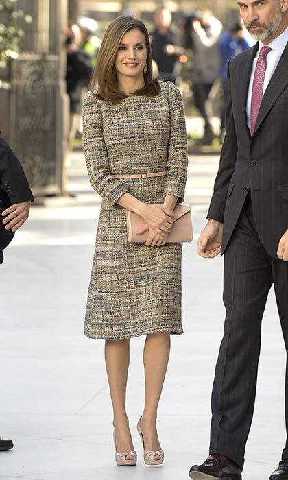 Queen Letizia looked characteristically stylish wearing a tweed dress, which she accessorized with a peach belt and matching clutch for the exhibition opening of Obras Maestros de Budapest at the Thyssen-Bornemisza Museum.