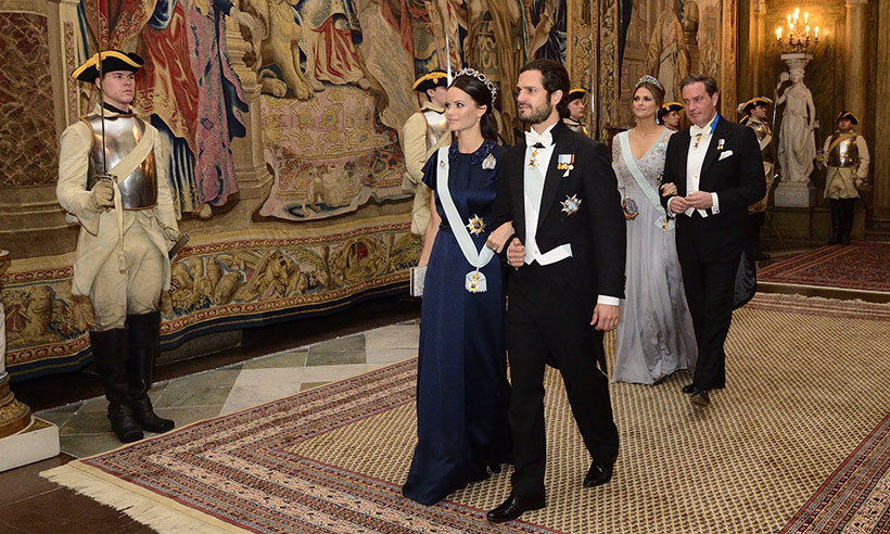 Prince Carl Philip and wife Princess Sofia arrive at the state banquet, with Princess Madeleine and husband, Chris O'Neill. 