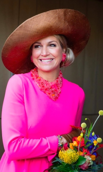 The Dutch royal proved you can never have too much pink when she stepped out in a fuschia dress with matching bib necklace and earrings during a visit to Krimpen aan den IJssel in the Netherlands. 