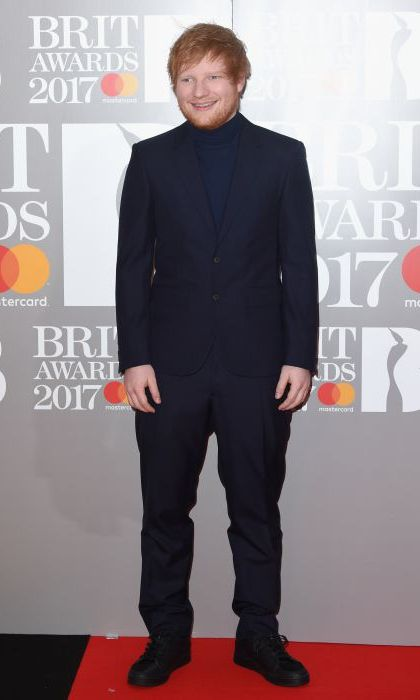 Ed Sheeran dressed up for his return to the BRITs in a black suit and poloneck jumper. 