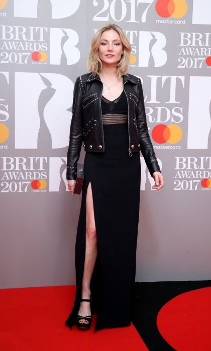 Clara Paget knows you can never go wrong in a black dress. The model paired her mesh detail gown with a leather biker jacket and strappy heels. 