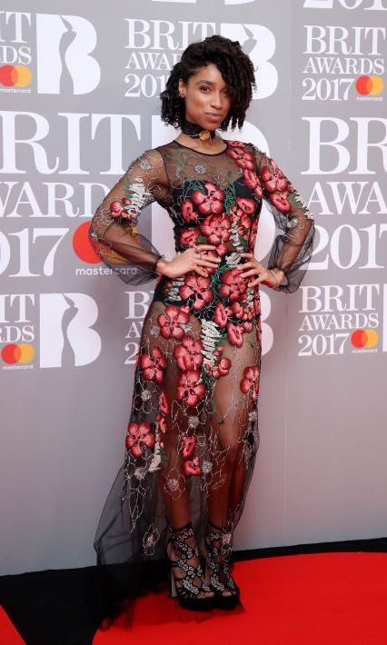 Lianne La Havas wore a sheer floral embellished dress for her red carpet appearance. The singer teamed the long-sleeved dress with a chunky choker and black platform heels. 