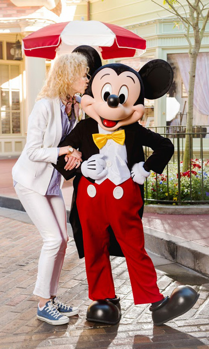 "Don't tell Keith! Oscar-winning actress Nicole Kidman placed a sweet smooch on Mickey Mouse during her ""magical family weekend"" at Walt Disney World's Magic Kingdom Park.