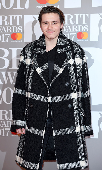 Brooklyn Beckham kept his sling under wraps as he attended the BRIT awards on Wednesday.