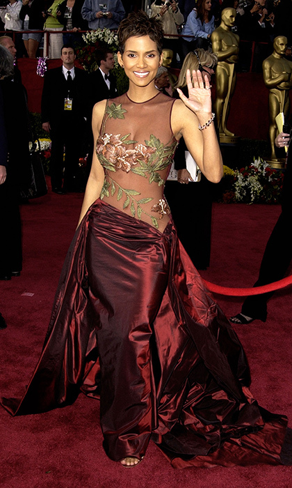<strong>Halle Berry in Elie Saab, 2002</strong><br><br>I remember watching the 2002 Oscars and my mum and I literally gasped when we saw Halle's dress. It managed to be daring and different and so incredibly beautiful all at once. While the <em>Monster's Ball</em> actress paired the Elie Saab net dress with sparkly rings and big stud earrings, she also had one hidden accessory: an antique emerald ring, given to her by her acting coach, that she carried in her purse for good luck. Clearly it worked: that was the night she became the first woman of colour to win the Oscar for best actress.<br><br><strong>Ishani Nath @FLAREfashion</strong>