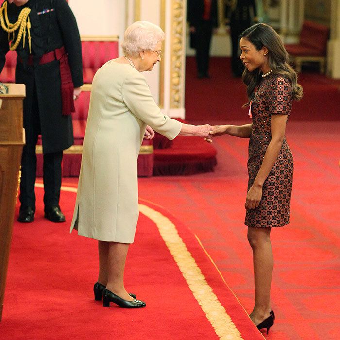 Naomie Harris was honoured by the Queen at Buckingham Palace for her services to drama on Thursday afternoon.