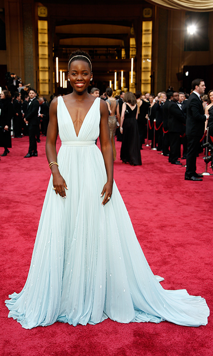 "<strong>Lupita Nyong'o in Prada, 2014</strong><br><br>Everything about this custom-made Prada gown on newcomer Lupita – from the gorgeous pale blue shade to the subtle sparkle to the deep plunge – was just right. She told Ryan Seacrest: ""It's a blue that reminds me of Nairobi, so I wanted to have a little bit of home.""<br><br><strong>Erinn Stewart @FLAREfashion</strong>"