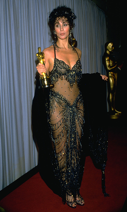 <strong>Cher in Bob Mackie, 1988</strong><br><br>Equal parts showmanship and skin, this bedazzled bikini of an Oscar gown is quintessential Cher. It's everything a good Dark Lady look should be: flamboyant and unspeakably sparkly. The showgirl headdress she wore two years earlier in 1986 (also a Mackie) may be better remembered, but this look is more important in the Cher canon: it's the night she won her first – and only – Oscar, for <em>Moonstruck</em>.<br><br><strong>Russ Martin @HelloCanada</strong>