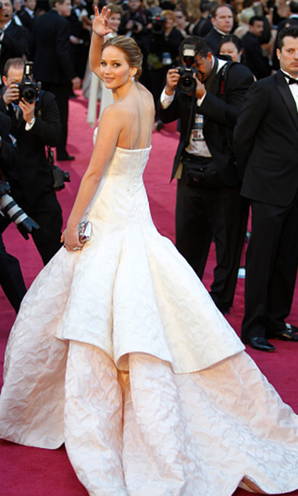 "<strong>Jennifer Lawrence in Dior Couture, 2013</strong><br><br>Already the face of Dior at 22, Jennifer established her place amid red-carpet royalty (and on the cover of <em>Hello! Canada</em>) in pale pink Dior Couture. Everything was breathtakingly, time-stoppingly perfect: the hair, the makeup, the gown, the trendsetting backwards necklace (by Chopard)! The most endearing moment, though, came when Jennifer tripped on her Cinderella dress on her way to accept the Best Actress Oscar. ""What do you mean, 'What happened?'"" she replied to curious reporters after the fact. ""I tried to walk upstairs in this dress, that's what happened!"" <br><br><strong>Alison Eastwood @HelloCanada</strong>"