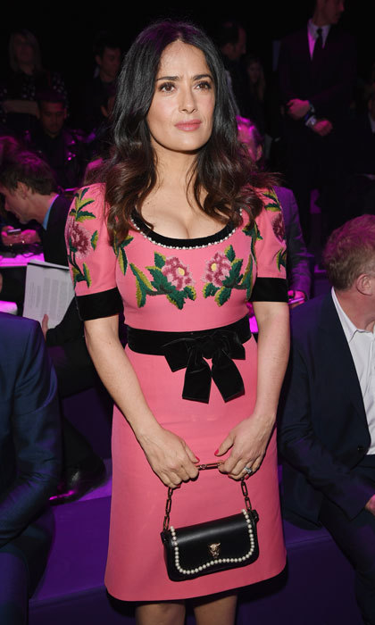 Salma Hayek looked pretty in pink sitting front row at the Gucci show.
