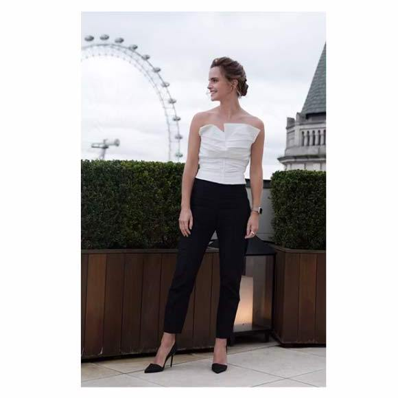 Storm Doris didn't interfere with Emma's style streak; the Harry Potter star braved the London weather in this white bustier top and black cigarette trousers from Spanish designer Carmen March. Burberry heels, Catbird earrings and a ring from Swedish jewellery label All Blues.