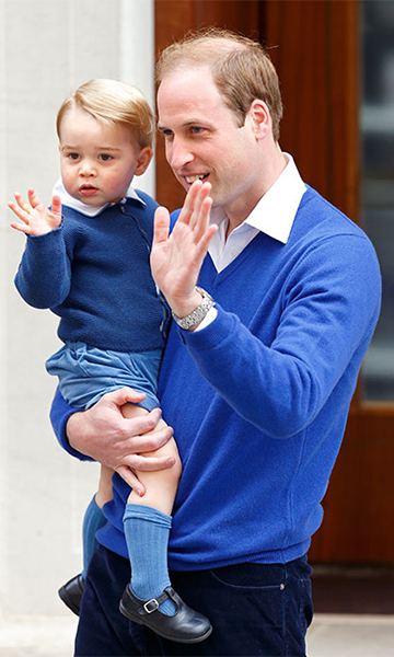 Prince George wearing a blue knitted cardigan by Amaia Kids as he visits his newborn sister Princess Charlotte in hospital.