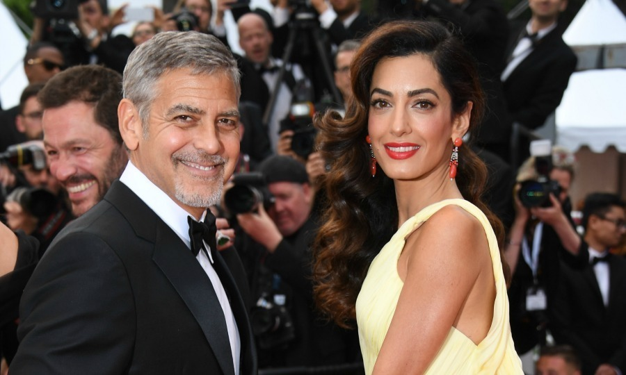 "Clooney party of four! George and Amal Clooney are expecting twins this year. The actor, who has been married to the human rights attorney since 2014, opened up about his exciting new journey to fatherhood. ""We are really happy and really excited. It's going to be an adventure,"" George said during his interview with Laurent Weil on the French program, Rencontres de Cinema. ""We've sort of embraced it all… with arms wide open.""