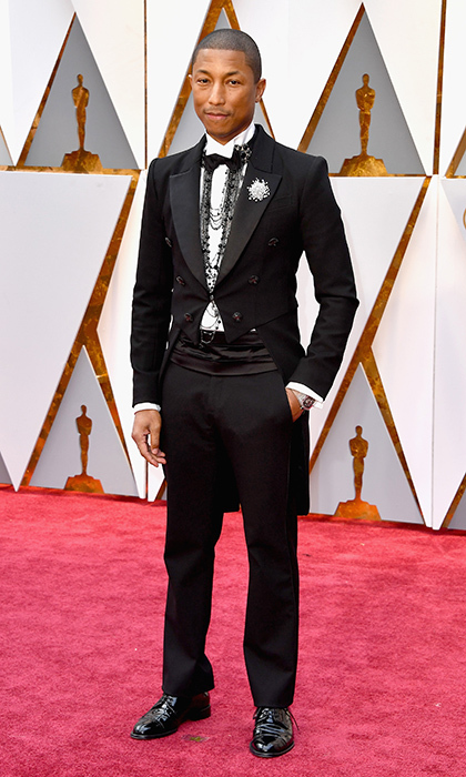 <h3>Pharrell Williams in Chanel</h3><p>Photo: © Getty Images</p>