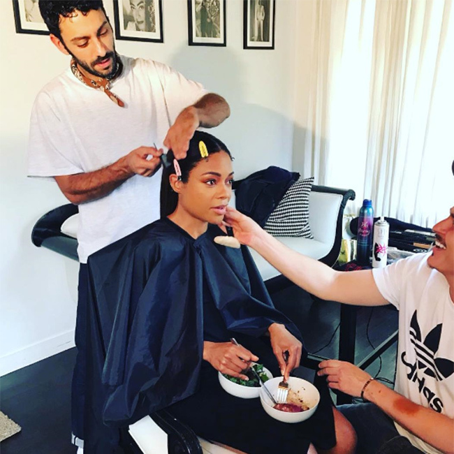 "Multitasking reached a whole new level in Naomie Harris' hotel room. The <em>Moonlight</em> star shared a snapshot showing her tucking in to some food while simultaneously having her hair and makeup done. ""Food and laughter with my hair and makeup peeps @peterluxhair @makeupbymario before hitting the red carpet,"" she wrote."