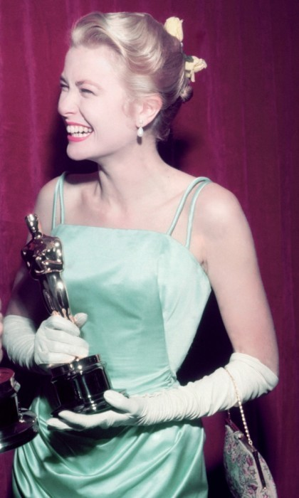 Seen here, Grace celebrates her Best Actress win for her role in the 1954 film <em>The Country Girl</em>.