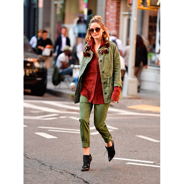Putting an elegant twist on army green by pairing her separates with Tibi's burnt orange suede shirt and Givenchy's brogue booties. 