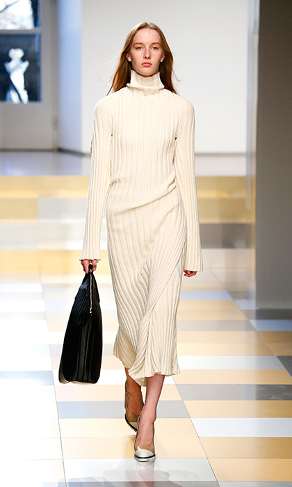 Clean and crisp while still feeling cozy and effortless, this knit cream one-piece by Jil Sander would best be worn to a relaxed family weekend dinner at Sandringham.