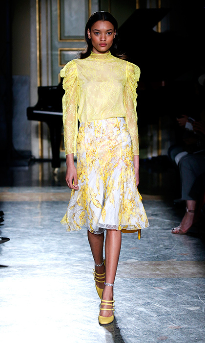 Apart from a few occasions (arriving at Calgary airport in summer 2011 and a garden party at the palace in 2013), Kate hasn't made a sartorial splash in yellow. Blumarine has created the perfect silhouette in just the right shade of lemon to meet all of the mother of two's credentials: knee-length fit and flair skirt, lace detailing and floral appliqués encrusted with shimmering crystals.  