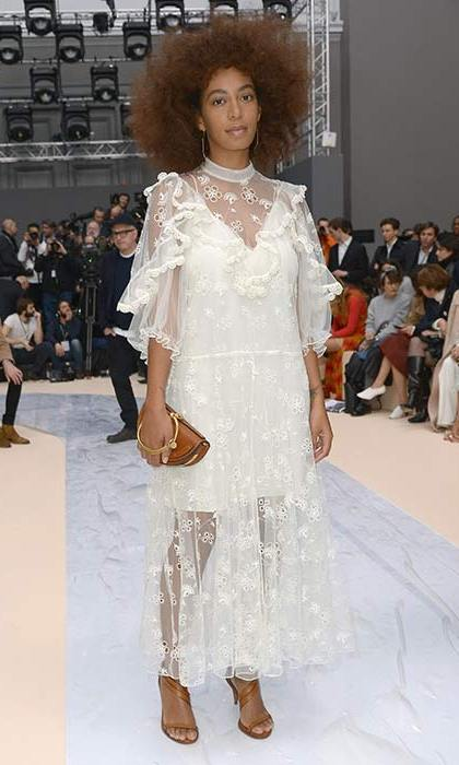 Solange Knowles looked ethereal in white lace as she joined the front row at the Chloe show, sitting alongside Emma Roberts and Isabelle Huppert.