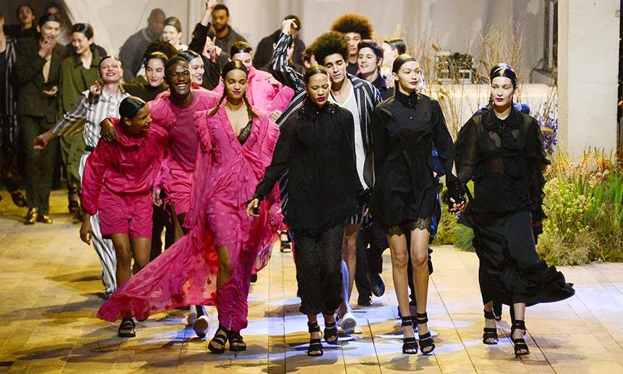 Models including Gigi and Bella Hadid and Winnie Harlow strutted their stuff in the H&M Studio show on Wednesday, as The Weeknd performed.