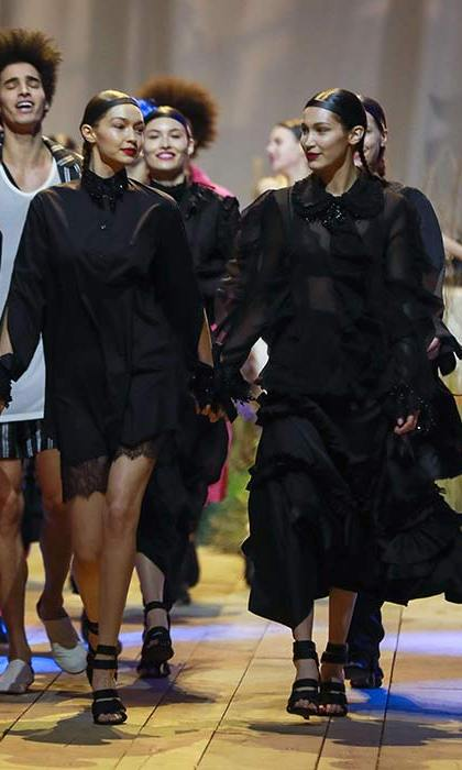 Gigi and Bella Hadid held hands and gave each other a knowing look as they walked in the H&M show finale, while Bella's ex-boyfriend The Weeknd performed.